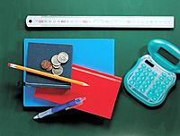 Ruler, notebook, coin and calculator