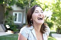 Woman standing outdoors laughing