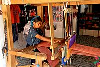 Woman using loom, San Antonio Palopo. Guatemala