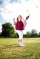 Girl playing badminton in the park