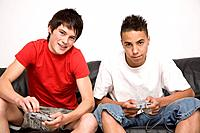 Boys playing video game console