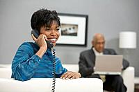 African businesswoman talking on telephone