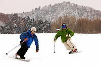 Asian men skiing