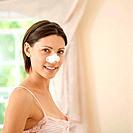 Woman using pore strip