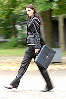 Young woman with brief case