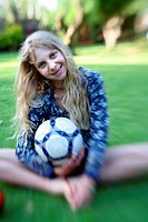 Girl posing with ball (thumbnail)