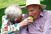 Senior couple with an apple