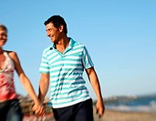 Mature adult couple on beach (thumbnail)