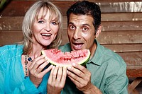 Mature adult couple with watermelon (thumbnail)