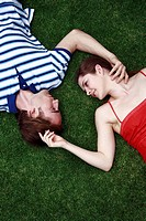 Young adult couple lying on the grass (thumbnail)