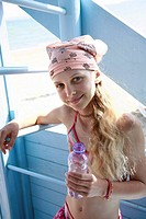 Girl on the beach with water bottle (thumbnail)