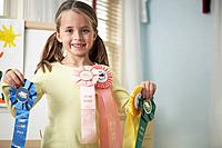 Girl showing award ribbons