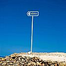 Island of Folegandros, Cyclades, Greece. desolated sign for the beach of Livadaki