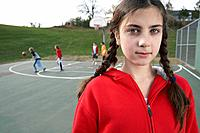 Girl hanging out at basketball court
