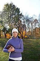 Woman holding a football