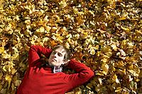 Man lying down in leaves