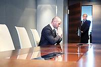 Businessman waiting nervously in conference room