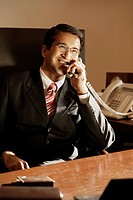 businessman on phone, in office