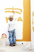 Boy painting wall