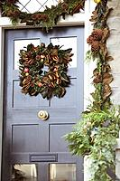 Christmas wreath hanging on front door