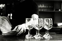 Wine glasses on counter of bar