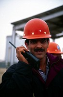 Burgan Oil Field Kuwait Oil Worker With Walkie Talkie