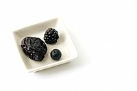 Prune, blackberry, and blueberry in dish