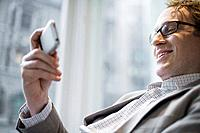 Man Text Messaging on Cell Phone