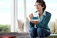 Middle Aged Woman Drinking Coffee