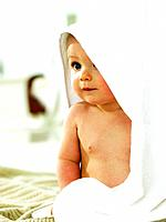 Baby sitting with towel over head (thumbnail)