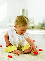 Baby playing with plastic letters
