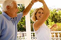 A couple in a gazebo dancing