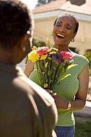 A man giving a woman flowers (thumbnail)
