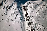 Person Snowboarding down Chute @ Eaglecrest Ski Resort Douglas Isl near Juneau Alaska SE Winter