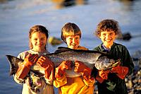 Kids holding King Salmon Juneau Southeast AK summer portrait