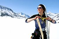 Woman Climber Attaches Climbing Skins to Skis AK SC Spring Chugach Mtns