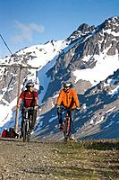 Men Biking on Power Line Pass Trail Glen Alps AK SC Chugach SP Summer