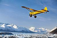 Piper Super Cub flying over Knik & Colony Glacier Matsu Valley Chugach Mountains Southcentral Alaska Summer