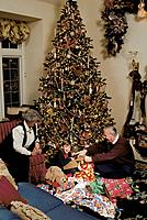Grandparents and Child Open Christmas Presents ANC AK Southcentral Hillside Tree