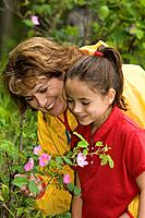 Mother & Daughter Enjoy Flowers w/Father Looking On @ Botanical Garden Summer Anchorage AK SC