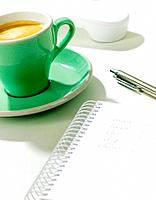 Cup of caffe latte on desk (thumbnail)