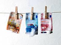 Clean Euro notes hanging on clothesline