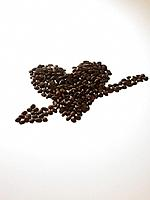Coffee beans in heart shape and arrow