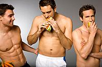 Men in shorts snacking on food