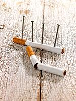 Close_up of nails on a cigarette
