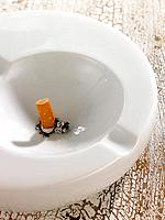 Close_up of a cigarette butt in an ashtray