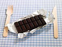 Close_up of chocolate with wooden fork and table knife