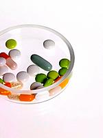 Close_up of pills and capsules in a bowl