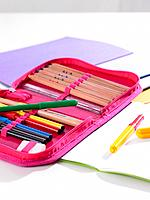 Close_up of pens and pencils in a pencil case