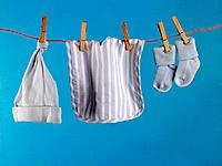 Close-up of baby clothing hanging on a clothesline (thumbnail)
